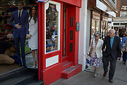 A life-size standee of Prince Harry and Meghan Markle with souvenirs and merchandise on sale in a the doorway of a tourist trinket window as the royal town of Windsor gets ready for the royal wedding between Harry and his American fiance, on 14th May 2018, in London, England.