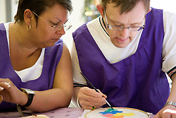 Day Service Care Assistant supervising service users with learning d