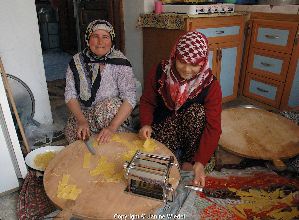 Women in kitchen making pasta in small rural village of Eymir in Anatolia Souther Turkey.