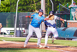 3 beats out his bunt<br /> <br /> 14 June 2021:  Ottawa Crusaders v University High Pioneers IHSA Regional Championship at Illinois Wesleyans Jack Horenberger Field<br /> <br /> (Photo by Alan Look)