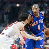 17 December 2009: New York Knicks guard Chris Duhon looks for a teammate while Chicago Bulls guard Kirk Hinrich defends on him during the Chicago Bulls 98-89 victory over the New York Knicks at the United Center, in Chicago, Illinois, USA.