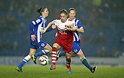 Charlton Athletic Ladies player Nikita Whinnett gets away from Brighton and Hove Albion Women's midfielder Jay Blackie during the FA Women's Premier League match between Brighton Ladies and Charlton Athletic WFC at the American Express Community Stadium, Brighton and Hove, England on 6 December 2015.