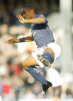 30/10/2004<br />FA Barclays Premiership - Fulham v Tottenham Hotspur - Craven Cottage, London<br />Tottenham Hotspur's Jermaine Defoe jumps to try and stop the ball form a goal kick<br />Photo:Jed Leicester/Back Page Images