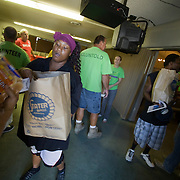 San Bernardino residents line up for free food provided by Second Chance Ministry. People received one bag of USDA food and a second bag of food donated directly from the church if they stayed for a church service.