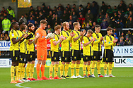 Brewers players giving a minutes applause during the EFL Sky Bet League 1 match between Burton Albion and Peterborough United at the Pirelli Stadium, Burton upon Trent, England on 27 October 2018.