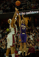 MORNING JOURNAL/DAVID RICHARD.Steve Nash, right, shoots a 3-pointer over Drew Gooden of Cleveland.