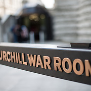 Sign in front of the entrance of the the Churchill War Rooms in London. The museum, one of five branches of the Imerial War Museums, preserves the World War II underground command bunker used by British Prime Minister Winston Churchill. Its cramped quarters were constructed from a converting a storage basement in the Treasury Building in Whitehall, London. Being underground, and under an unusually sturdy building, the Cabinet War Rooms were afforded some protection from the bombs falling above during the Blitz.