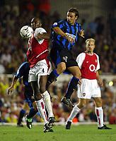 Photograph: Scott Heavey,  Digitalsport<br /> Arsenal v Inter. Champions League. 17/09/2003.<br /> Patrick Viera shields the ball from Christiano Znetti (R).