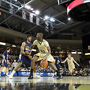 Central Florida forward Keith Clanton (33) drives the ball against Arsalan Kazemi (14) of Iran during a Conference USA NCAA basketball game between the Rice Owls and the Central Florida Knights at the UCF Arena on January 22, 2011 in Orlando, Florida. Rice won the game 57-50 and extended the Knights losing streak to 4 games.  (AP Photo/Alex Menendez)