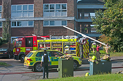 © Licensed to London News Pictures. 20/08/2019.<br /> Orpinton ,UK. London Fire Brigade, Police and the London Ambulance Service are all in attendence this morning at a serious flat fire in Petten Grove, Orpington, South East London which has seen three people taken to hospital suffering from smoke inhalation one of the three is a child. A police cordon is in place as fire investigation officers work on scene. Photo credit: Grant Falvey/LNP