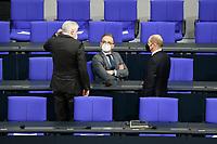 11 FEB 2021, BERLIN/GERMANY:<br /> Horst Seehofer (L), CSU, Bundesinnenminister, Heiko Maas (M), SPD, Bundesaussenminister, und Olaf Scholz (R), SPD, Bundesfinanzminister, im Gespraech, vor Beginn der Regierungserklaerung der Bundeskanzlerin zur Bewaeltigung der Corvid-19-Pandemie, Plenum, Reichstagsgebaeude, Deutscher Bundestag<br /> IMAGE: 20210211-01-003<br /> KEYWORDS: Corona, Gespräch, Mundschutz, Maske