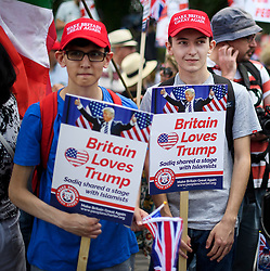 © Licensed to London News Pictures. 14/07/2018. London, UK. Supporters of U. S President Donald Trump take part in a rally at the The U. S Embassy in London. Trump is on his third day of a 4 day visit to the UK, which so far has seen him hold talks with British PM Theresa May and meet HRH Queen Elizabeth II. Photo credit: Ben Cawthra/LNP