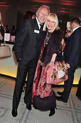 HAROLD TILLMAN and VIRGINIA BATES at a private view of Ballgowns: British Glamour Since 1950 at the V&A museum, London on 15th May 2012.