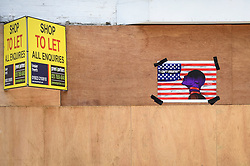 "© Licensed to London News Pictures. 13/06/2020. WATFORD, UK.  A sign on construction hoarding bearing the text ""I Can't Breathe"" in Watford High Street, north west London.  The sign references the death of George Floyd, an unarmed black man, who died whilst being arrested by police in Minneapolis, USA, in May.  His death has brought a renewed focus to the issue of racism and police brutality, including Black Lives Matter protests in cities across the world.  Photo credit: Stephen Chung/LNP"