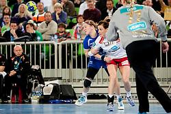 Maja Zrnec #44 of Krim and Linn-Kristin Koren Reigelhuth #11 of Larvik during handball match between RK Krim Mercator (SLO) and Larvik HK (NOR) in second game of semi final of EHF Women's Champions League 2012/13 on April 13, 2013 in Arena Stozice, Ljubljana, Slovenia. (Photo By Urban Urbanc / Sportida).