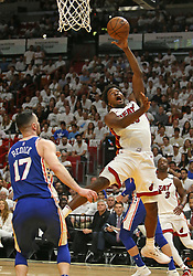 April 19, 2018 - Miami, FL, USA - The Miami Heat's Justise Winslow, right, goes to the basket against the Philadelphia 76ers' JJ Redick during the first quarter in Game 3 of a first-round NBA playoff series at AmericanAirlines Arena in Miami on Thursday, April 19, 2018. (Credit Image: © David Santiago/TNS via ZUMA Wire)
