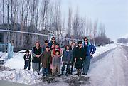 Photographer and author Louie Psihoyos with John Knoebber and Uzbekistan family.