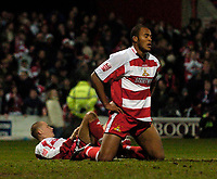 Photo: Jed Wee.<br /> Doncaster Rovers v Arsenal. Carling Cup. 21/12/2005.<br /> <br /> Doncaster's Sam Oji (R) and Steve Roberts collapse in disappointment after conceding the late equaliser.