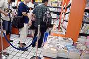 inside anime bookstore people in line waiting to pay