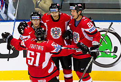 Roland Kaspitz of Austria, Matthias Trattnig of Austria, Thomas Raffl of Austria and Darcy Werenka of Austria celebrate during ice-hockey match between Austria and Slovenia of Group G in Relegation Round of IIHF 2011 World Championship Slovakia, on May 7, 2011 in Orange Arena, Bratislava, Slovakia. (Photo By Vid Ponikvar / Sportida.com)