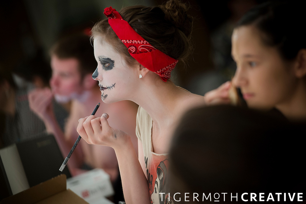 Theatre students work on the art of fantasy makeup during a class in Brown Theatre.