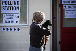 "© Licensed to London News Pictures . 07/05/2015 . Doncaster , UK . Judith Preston with her Shetland Lamb "" Beth "" , voting at Sutton Village Hall polling station in Ed Miliband's constituency of Doncaster North . Photo credit : Joel Goodman/LNP"
