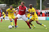 Ebbsfleet united attacker Danny Kedwell (9) holding off AFC Wimbledon Jimmy Abdou (8) during the Pre-Season Friendly match between Ebbsfleet and AFC Wimbledon at Stonebridge Road, Ebsfleet, United Kingdom on 29 July 2017. Photo by Matthew Redman.