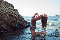 """Woman experiencing yoga on the seashore.<br /> :::<br /> """"Embrace each of your senses in turn;<br /> Seeing as being touched by light.<br /> Hearing as immersion in an ocean of sound.<br /> Tasting as enlightening.Smelling as knowing.<br /> Touching as electrifying.<br /> Then leave all these behind,<br /> Enter the spaciousness of the heart,<br /> Intimate with the unknowable.""""<br /> -The Radiance Sutras translated by Lorin Roche"""