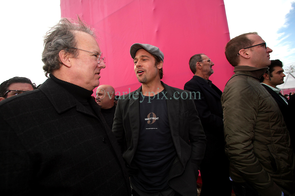 Dec 03 2007. New Orleans, Louisiana. Lower 9th Ward.<br /> Brad Pitt revisits the Lower 9th ward, devastated by Hurricane Katrina to present 'Make it Right' where architects' designs are unveiled to the public. Brad with architects backstage before giving a presentation to the press and public.<br /> Photo credit; Charlie Varley.