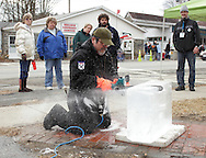 Wurtsboro, New York  - A man carves a block of ice with a chain saw during the ice carving competition at the Wurtsboro Winterfest on Feb. 11, 2012. ©Tom Bushey / The Image Works