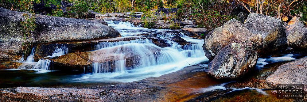 A panoramic photograph of a small waterfall hidden in the wilderness of the Great Dividing Range west of Cairns.<br /> <br /> Limited Edition of 125