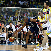 Fenerbahce Ulker's Oguz SAVAS (R) and Efes Pilsen's Charles SMITH (L) during their Turkish Basketball league Play Off Final third leg match Fenerbahce Ulker between Efes Pilsen at the Abdi Ipekci Arena in Istanbul Turkey on Tuesday 25 May 2010. Photo by Aykut AKICI/TURKPIX
