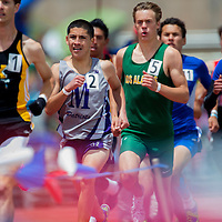 051615       Cable Hoover<br /> <br /> Miymura Patriot Niles Thomas attempts to chase down the lead St. Pius runner in the 800m race during the New Mexico State Track Meet Saturday at the University of New Mexico Stadium in Albuquerque.