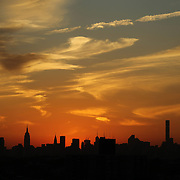 NEW YORK, NEW YORK - SEPTEMBER 26:   The Manhattan skyline at sunset showing the Empire State Building, (highest point, left) and the Chrysler building shot from Citi Field Stadium during the Atlanta Braves Vs New York Mets MLB regular season game at Citi Field, Flushing, Queens, on September 26, 2017 in New York City. (Photo by Tim Clayton/Corbis via Getty Images)