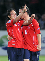 Chile win 1-0 over Argentina in their 2010 World Cup qualifying soccer match in Santiago, October 15, 2008.<br /> Chile's Fabian Orellana (C) celebrates with team mate Carlos Carmona after scoring a goal against Argentina during their 2010 World Cup qualifying soccer match in Santiago, October 15, 2008.<br /> © Dupla / PikoPress