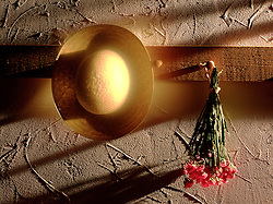 straw hat with dried flowers on wooden wall peg dramatic side light w warm golden glow of light beneath behind hat Alone Abandon CONCEPT STOCK PHOTOS CONCEPT STOCK PHOTOS