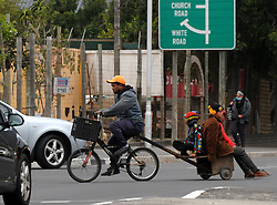 SOUTH AFRICA - Cape Town - 27 May 2020 - Coronavirus Lockdown - A cyclist, with a makeshift trailer, carrying three children navigates his way on the busy Main Road Retreat  Picture: Tracey Adams/African News Agency (ANA)