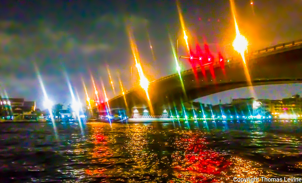 Abstract<br /> The brilliant colors are intense and interesting in shape and form, on the water, and off. A bridge in Bangkok