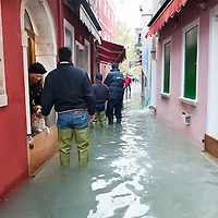 Local shop keepers monitor the situation of the rising water in Burano. More than 59% of Venice was under water on Thursday, as the historic lagoon town was hit by exceptionally high tides. The sea level rose above 140cm overnight and was expected to remain above critical levels for about 15 hours.