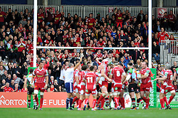 Scarlets supporters in the crowd celebrate as their team score a try - Photo mandatory by-line: Patrick Khachfe/JMP - Tel: Mobile: 07966 386802 12/10/2013 - SPORT - RUGBY UNION - Twickenham Stoop - London - Harlequins V Scarlets - Heineken Cup
