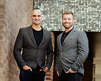 Business partners group portrait featuring two business men in sports jackets taken outside using managed daylight