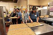 Lola Milholland serves her Umi Noodles in the Portland Public Schools.