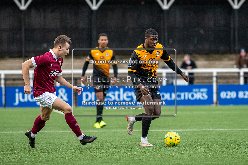 BROMLEY, UK - DECEMBER 07: Ben Mundelle, of Cray Wanderers FC, glides past his defender during the BetVictor Isthmian Premier League match between Cray Wanderers and Potters Bar Town at Hayes Lane on December 7, 2019 in Bromley, UK. <br /> (Photo: Jon Hilliger)