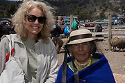 Indian woman & Renee<br /> Calpi animal market<br /> Parish of Riobamba, Chimborazo Province<br /> Andes<br /> ECUADOR, South America