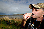 Quack, quack ... With duck hunting season about to kick off Invercargill resident Corey Carston practices his duck-calling. PHOTO: GIORDANO STOLLEY/ Otago Daily Times (Note: This image can only be purchased directly from the Otago Daily Times)