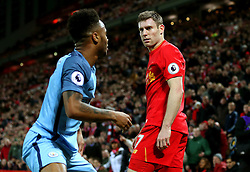 James Milner of Liverpool stares towards a dejected Raheem Sterling of Manchester City - Mandatory by-line: Matt McNulty/JMP - 31/12/2016 - FOOTBALL - Anfield - Liverpool, England - Liverpool v Manchester City - Premier League