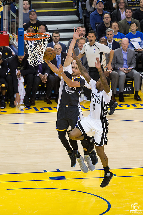 Golden State Warriors guard Stephen Curry (30) takes the ball to the basket during a fast break against the Brooklyn Nets at Oracle Arena in Oakland, Calif., on February 25, 2017. (Stan Olszewski/Special to S.F. Examiner)