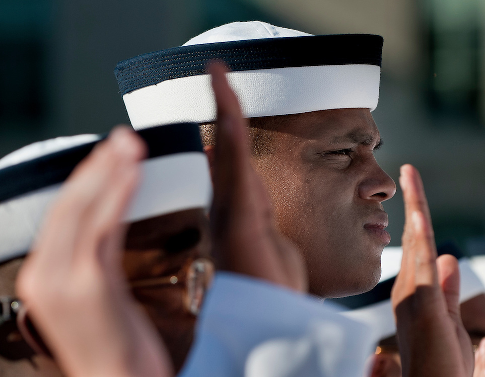 """A midshiman takes the Oath of Office with his fellow Plebes at the US Naval Academy in  Annapolis, MD. Approximately 1,230 young men and women arrived at the U.S. Naval Academy's Alumni Hall, Thursday, July 1, for Induction Day to begin their new lives as """"plebes"""" or midshipmen fourth class (freshmen). """"I-Day"""" culminates when the members of the Class of 2014 take the oath of office at a ceremony at 6 p.m. in Tecumseh Court, the historic courtyard of the Bancroft Hall dormitory. Over 17,400 young men and women applied to be members of the Naval Academy Class of 2014 - a record for USNA."""