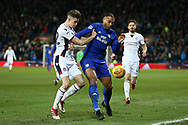 Reece Burke of Bolton Wanderers (l) challenges Kenneth Zohore of Cardiff city ®. EFL Skybet championship match, Cardiff city v Bolton Wanderers at the Cardiff city Stadium in Cardiff, South Wales on Tuesday 13th February 2018.<br /> pic by Andrew Orchard, Andrew Orchard sports photography.