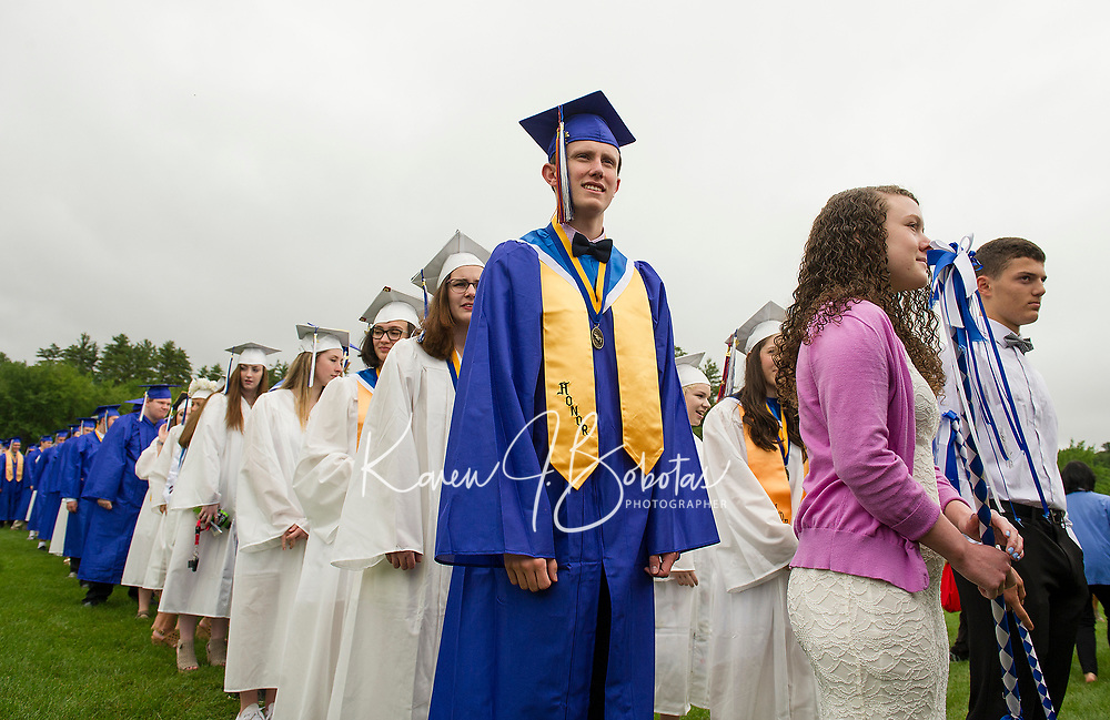 The Inter-Lakes Class of 2017 lines up to begin graduation ceremonies Saturday morning at Prescott Park in Meredith.  (Karen Bobotas/for the Laconia Daily Sun)